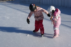 Playing ice hockey with a friend
